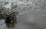 Wheel Chair Stuck in River Mud